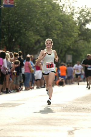 Record-Eagle/Keith King<br /> Kristal Studer, of Ohio, finishes first in the women's 15K during the National Cherry Festival Festival of Races.