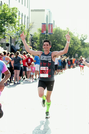 Record-Eagle/Keith King<br /> Jordan Desilets, of Pinckney, finishes first in the men's 15K during the National Cherry Festival Festival of Races.