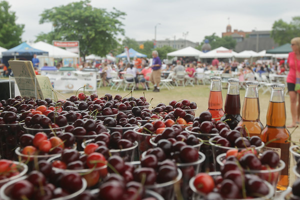 Record-Eagle/Keith King<br /> Cherries are displayed for sale at a Gallagher's Farm Market and Bakery table during the National Cherry Festival.