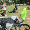 Record-Eagle/Keith King<br /> Jason Harris, from left, 15, his mother Julie Harris and Jordan Harris, 13, all of Saline, set up tents in preparation to spend the night at the Grand Traverse County Civic Center after bicycling from Leland with other participants in the Michigander bicycle tour. Approximately 400 participants are spending the night at the Grand Traverse County Civic Center and will continue the tour in the morning when they leave for Cadillac.