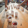 Record-Eagle/Keith King<br /> Cherries lie in cups on a table for runners after they finish the National Cherry Festival Festival of Races.