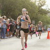 Record-Eagle/Keith King<br /> Megan O'Neil, of Stanwood, finishes first in the women's 10K during the National Cherry Festival Festival of Races.