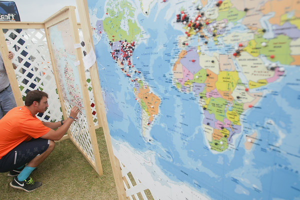 Record-Eagle/Keith King<br /> Kurtis Condon, of Hillsdale, places a pin on a map during the National Cherry Festival.