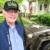 Record-Eagle/Nathan Payne<br /> Gordon Snowden will ride in the Cherry Royale parade alongside his friend and fellow Korean War veteran Willis Remus this morning in a vintage army Jeep.