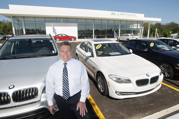 Record-Eagle/Keith King<br /> Glenn Cousineau, general sales manager, stands Friday, July 12, 2013 at BMW of Traverse City.