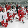 Record-Eagle/Keith King<br /> Hockey players listen Wednesday, July 10, 2013 during the Detroit Red Wings skill development camp at Centre ICE in Traverse City.