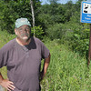 Record-Eagle/Keith King<br /> Bryan Black, of Inland Township, stands Thursday, July 11, 2013 along Lake Ann Road south of Douglas Road, near the Platte River Watershed .