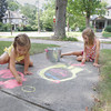 Record-Eagle/Keith King<br /> Hazel Wade, left, 4, along with friend and neighbor, Erinn Hale, 5, both of Traverse City, create art using sidewalk chalk Friday, July 19, 2013 in Traverse City.