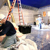 Record-Eagle/Keith King<br /> Kelly Bemiss, a service electrician with Feyen Zylstra electrical contractors, works on wiring for outlets and general power Tuesday, July 16, 2013 as construction takes place at the Con Foster Museum building to turn it into a movie theater called Bijou by the Bay.