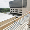 Record-Eagle/Keith King<br /> Ed Belanger, facilities maintenance manager, explains a white membrane used on roofs Tuesday, July 9, 2013 at Munson Medical Center in Traverse City. The white membrane aids in cooling as it prevents the surface from absorbing heat.