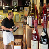Record-Eagle/Jan-Michael Stump<br /> The Elk Rapids Wine Shop co-owner Rob Crandell (cq) stocks some of the over 400 wines, in addition to gourmet food items.