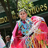 Record-Eagle/Jan-Michael Stump<br /> Dancers with the Grand Traverse Band of Ottawa and Chippewa Indians make their way down Front Street during Saturday's National Cherry Festival Cherry Royale Parade.