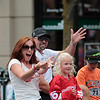 Record-Eagle/Jan-Michael Stump<br /> Cherry Royale Parade Marshall and Detroit Red Wing Tomas Holmstrom rides with his family in Saturday's parade.