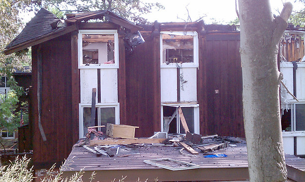 Record-Eagle/James Russell<br /> A dozen units at Alpine Apartments on Munson Avenue were destroyed by fire early Monday.