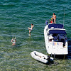 Record-Eagle/Jan-Michael Stump<br /> Boaters swim in West Grand Traverse Bay near the Open Space on Monday.