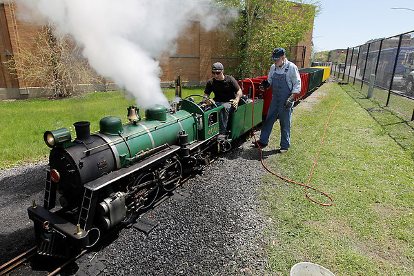 Record-Eagle/Keith King<br /> Tucker Bailey, left, and Don Frost tune up the Spirit of Traverse City train in May 2011 at Clinch Park.