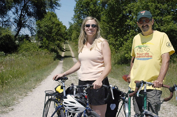 Record-Eagle/Lisa Perkins<br /> The 11th annual Tour de TART will, for the last time, include 6.5 miles of unpaved trail. Julie Clark, executive director of TART Trails and her predecessor Bob Otwell are working on plans to pave the trail between Lakeview and Revold roads.