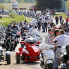Record-Eagle/Keith King<br /> Participants gather near Classic Motor Sports prior to the start of the annual Ride for Father Fred hosted by the Northern Chapter Harley Owners Group. Motorcyclists in the event begin at Classic Motor Sports and travel toward the Old Mission Lighthouse before returning to conclude their ride at the Veterans of Foreign Wars Cherryland Post 2780 on Veterans Drive.
