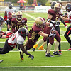 Record-Eagle/Keith King<br /> The Traverse City Wolves' Jesse Kethman dives for a touchdown against the Southeast Michigan Mercenaries Saturday at Thirlby Field.