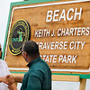 Record-Eagle/Jan-Michael Stump<br /> Keith Charters (cq), left, shakes hands with Michigan Department of Natural Resources Director Rodney Stokes during a ceremony in which Traverse City State Park was renamed Keith Charters Traverse City State Park during a ceremony Wednesday near the park's beach on East Grand Traverse Bay. Charters was honored for his long time service and accomplishments with the Michigan Department of Natural Resources. Charters served 20 years on the state's Natural Resources Trust Fund and 16 years as chairman of the state Natural Resources Commission.