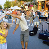 Record-Eagle/Keith King<br /> Dana Hennrick, 9, of Traverse City, twirls while dancing with her father, Gerald, at Friday Night Live.