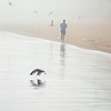 Record-Eagle/Jan-Michael Stump<br /> Tenzin Lhundup, of New York, takes a foggy morning run along Clinch Beach.