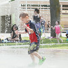 Record-Eagle/Keith King<br /> Bradley Potvin, 4, of Traverse City, plays at the William G. Milliken Waterscape at Clinch Park in Traverse City.