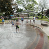 Record-Eagle/Keith King<br /> Children play at the William G. Milliken Waterscape at Clinch Park in Traverse City.