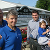 Record-Eagle/Glenn Puit<br /> Rob and Marcy Ford, left, along with Clinton and Diana Shattuck, right and daughter Hayden stand in front of Riverside Title in Elk Rapids. The Fords are selling the business to the Shattucks.