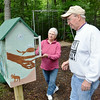 Record-Eagle/Allison Batdorff<br /> John and Molly McCombs visit the Little Free Library in Killingsworth Park near their home in East Bay Township.