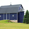 """Record-Eagle photos/Allison Batdorff<br /> Above, the Irish barn in Fife Lake wears the blue of Tom Irish's alma mater, University of Michigan. Left, Barns have a lofty purpose about them, which is why """"barn weddings"""" are the current rage."""