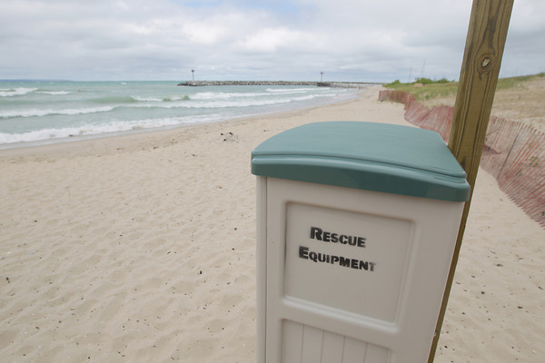 Record-Eagle/Keith King<br /> A storage cabinet with rescue equipment stands Tuesday, July 23, 2013 near Lake Michigan on Van's Beach in Leland.