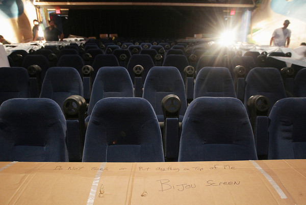 Record-Eagle/Keith King<br /> A box labeled 'Bijou screen' lies on theater chairs Friday, July 26, 2013  as work takes place in the Bijou by the Bay theater in Traverse City.