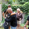 Record-Eagle/Keith King<br /> Rick Hansen, father of Justin Hansen, a United States Marine who used to live in Kingsley, shares a hug with Arica Zenner as her husband Dave Zenner, back left, and Vickie Hays, right, mother of Justin, stand near Wednesday, July 25, 2012 in Whitewater Township. Justin Hansen was killed in Afghanistan. Justin was in the wedding of Dave and Arica with Justin and Dave being friends since grade school.