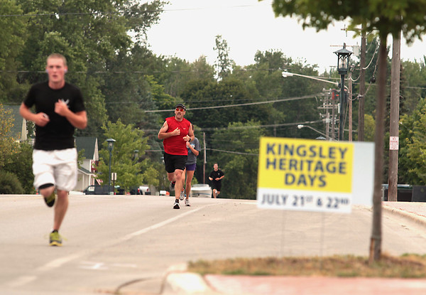 Record-Eagle/Keith King<br /> Runners make their way toward the finish line Saturday, July 21, 2012 during the Kingsley Heritage Days run.