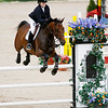 Record-Eagle/Jan-Michael Stump<br /> Catherine Hanlon, of Chicago, jumps Helsinki in the NAL $5000 LO Jr.AO Jumper Classic at Horse Shows by the Bay Saturday at Flintfields Horse Park in Williamsburg.