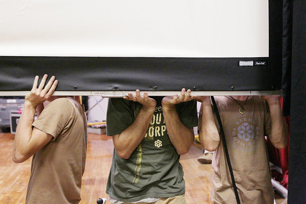 Record-Eagle/Keith King<br /> A projection screen is put into place with the help of the SEEDS Youth Conservation Corps in Lars Hockstad Auditorium at Central Grade School in preparation for the Traverse City Film Festival.
