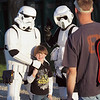"Record-Eagle/Keith King<br /> Evan Chase, 5, of Traverse City, has his photo taken by his father, Chris, as he stands with characters from ""Star Wars"" movies at the Open Space."
