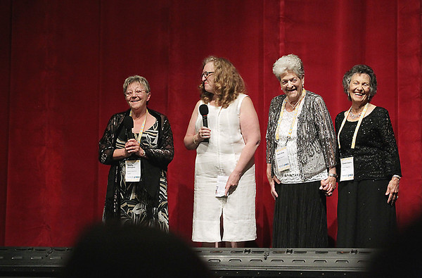 "Record-Eagle/Keith King<br /> Kathleen Glynn, second from left, stands with Sheila Douglas, left; Vera Sime, second from right; and Gwen Davis as they address the audience in the State Theatre prior to the showing of ""Made in Dagenham."" Glynn's guests were real-life participants in a Ford Motor Plant strike on which the film is based."