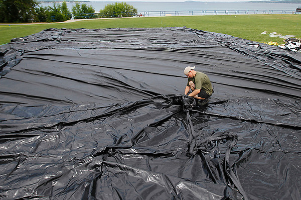 Record-Eagle/Jan-Michael Stump<br /> Jake Cook, of Outdoor Movies, works on rigging for the big screen at the Open Space for evening movies during the Traverse City Film Festival. This year's screen is 100 feet wide and 42 and a half feet tall, larger than last year's 65-foot-by-32-foot screen.