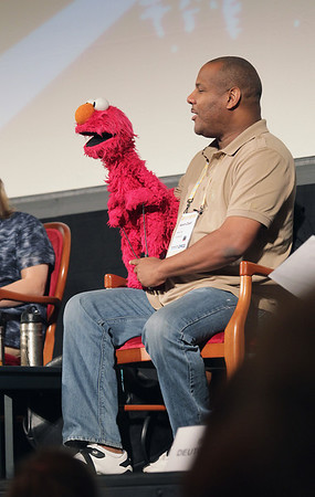 """Record-Eagle/Keith King<br /> Puppeteer Kevin Clash holds Elmo as he talks Wednesday during the Traverse City Film Festival """"Being Elmo"""" panel session at the City Opera House."""