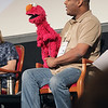 "Record-Eagle/Keith King<br /> Puppeteer Kevin Clash holds Elmo as he talks Wednesday during the Traverse City Film Festival ""Being Elmo"" panel session at the City Opera House."