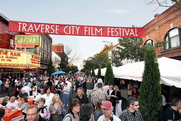 Record-Eagle/Keith King<br /> Attendees of the Traverse City Film Festival Opening Night Party stroll, mingle, eat and drink along Front Street on Tuesday.