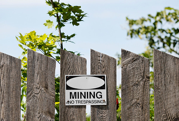 Record-Eagle/Jan-Michael Stump<br /> A sign outside a gravel pit off Neuman Road in Leelanau County's Kasson Township warns against trespassing.
