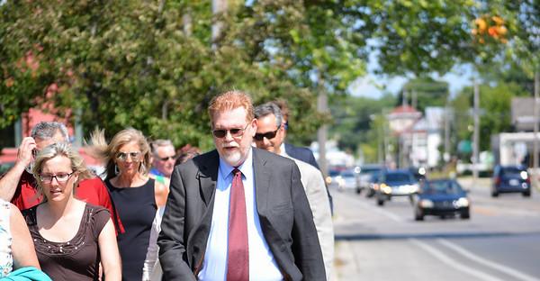 Record-Eagle/Dan Nielsen<br /> Dr. Debra Graetz and City Manager Marty Colburn walk along Eighth Street.