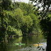 Record-Eagle/Keith King<br /> Kayakers paddle on the Boardman River Thursday in Traverse City.