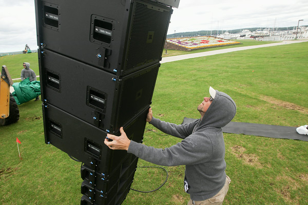 Record-Eagle/Keith King<br /> Jake Cook, with Outdoor Movies, sets up audio at the Open Space as preparations take place for the Traverse City Film Festival.