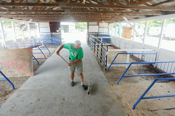 Record-Eagle/Keith King<br /> Drew Alpers, Steer Specie Chair for the Northwestern Michigan Fair 4-H Livestock Council, sweeps the steer barn as preparations are made for the upcoming Northwestern Michigan Fair in Blair Township.