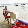 Record-Eagle/Keith King<br /> Nick Ferrugia, owner of Long Lake Grocery, prepares to deliver pizza on Long Lake using a personal watercraft.