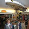 Record-Eagle/Glenn Puit <br /> Beryl Skrocki, owner of Sleeping Bear Surf & Kayak, stands in the Empire shop. The store recently celebrated its 10th anniversary.